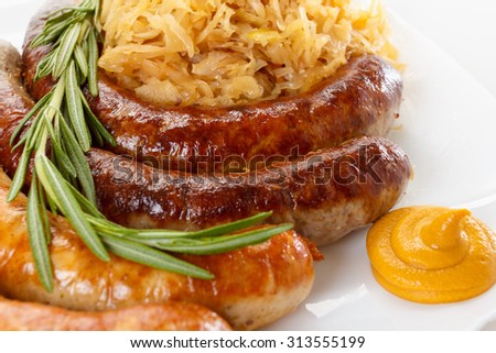 Traditional Octoberfest menu, plate of sausages and sauerkraut. Oktoberfest meal. - stock photo