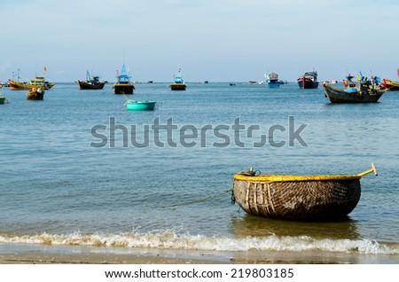 Traditional of the basket shape boat, Fishing village at Mui Ne, Vietnam. - stock photo