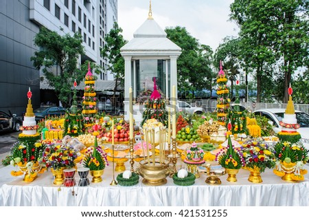 Traditional offerings to gods with flowers and aromatic sticks. Food or vegetable or fruit offerings for the gods of Thailand culture - stock photo
