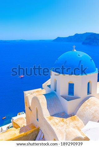 Traditional old church with blue colored dome in Oia the most beautiful village of Santorini island in Greece