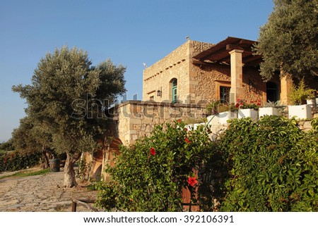 Traditional old farm house with garden, Crete island, Greece - stock photo