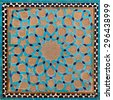 Traditional old Islamic design with flowers and stars made of brown clay and blue tiles in Yazd. - stock photo