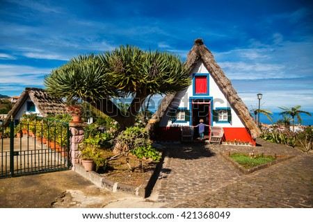 traditional old Madeira house, built of wood and thatched with straw  - stock photo