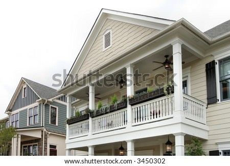 Traditional old-South style homes.  Focus on the outdoor living balcony area. - stock photo