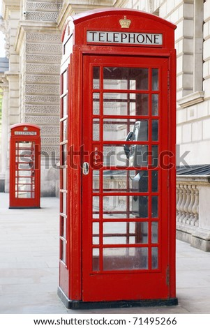 Traditional Old Style British Red Phone Boxes on a London Street - stock photo