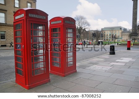Traditional old style red phone booths at English street - stock photo