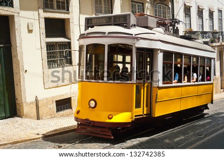 Traditional old touristic tram in Lisbon, Portugal - stock photo