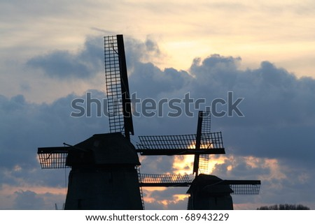 Traditional old windmills near the village of Schermerhorn in Holland - stock photo