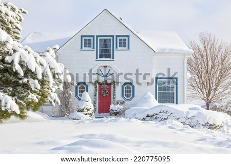 Traditional older North American house decorated for Christmas. - stock photo