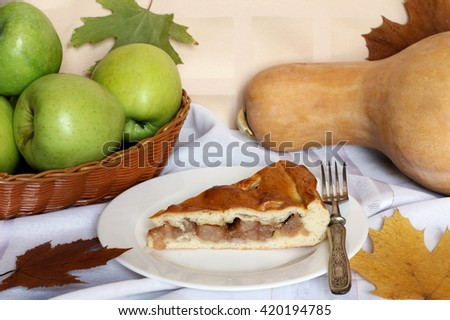 Traditional organic Apple Pie dessert, yeast dough, brown sugar, cinnamon, decorated with vintage fork, green apples, pumpkin, dried roses and autumn foliage, close up view, selective focus - stock photo