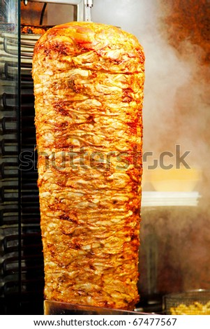 Traditional oriental cuisine giros meat at grill - stock photo