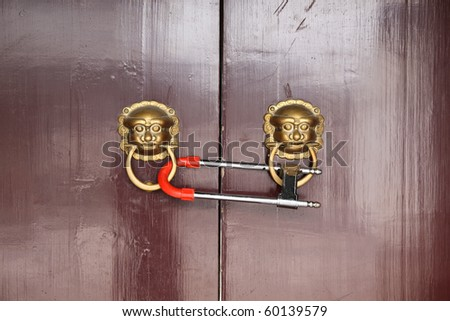 traditional oriental door with lock - stock photo