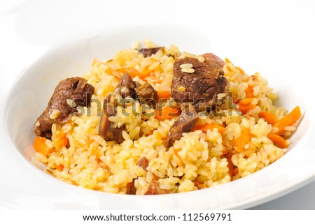 Traditional oriental pilaf  on a white plate
