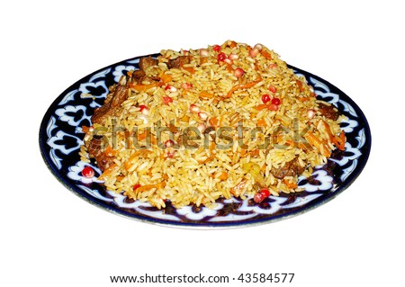 Traditional oriental pilaf with mutton and pomegranate on plate isolated on white with selective focus - stock photo