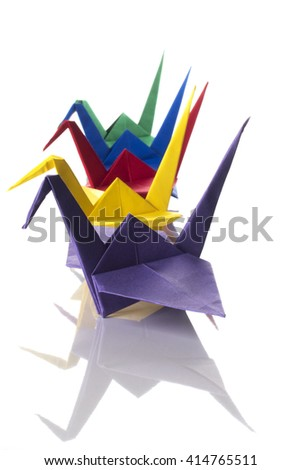 Traditional origami birds (cranes) made from colored paper isolated on white background - stock photo