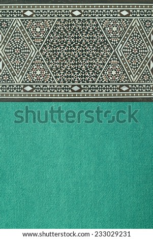 traditional ornaments on textile background - stock photo