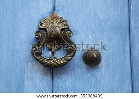 Traditional Ornate Door Handle Or Knocker Against A Blue Painted Wooden Door,  Cartagena, Colombia