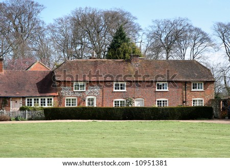Traditional part Brick and Flint  English Village Houses with a Cricket Green in front