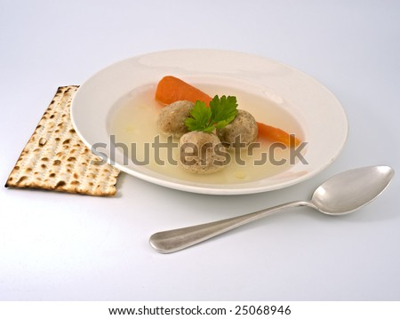 traditional passover matzo ball soup with spone and matza. - stock photo