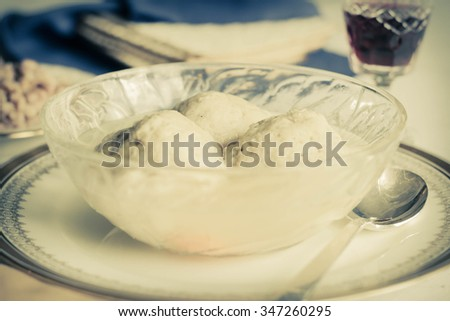 Traditional passover matzoh ball soup with unleavened bread and wine