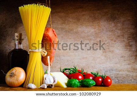 Traditional pasta cooking ingredients on a wooden background with text copy space - stock photo