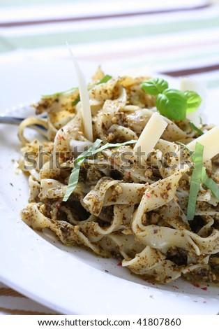 traditional pasta with pesto sauce, narrow focus - stock photo