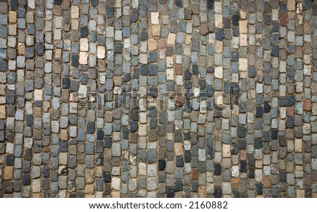 Traditional pavement; a street paved with cobblestone - stock photo