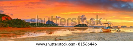 Traditional philippine boat bangka at sunset time. Panorama - stock photo