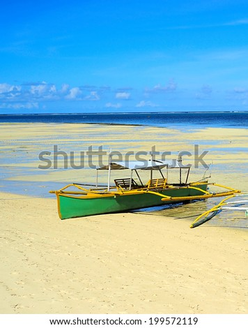 Traditional Philippines boats on the beach during the low tide on Shiargao island, Philippines - stock photo