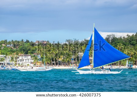 Traditional philippines sailing boats  at White Beach of Boracay island - stock photo