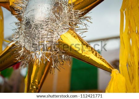 traditional pinata star shape from mexico, important part of parties and celebrations in mexican culture, very popular during posadas parties and independence day - stock photo
