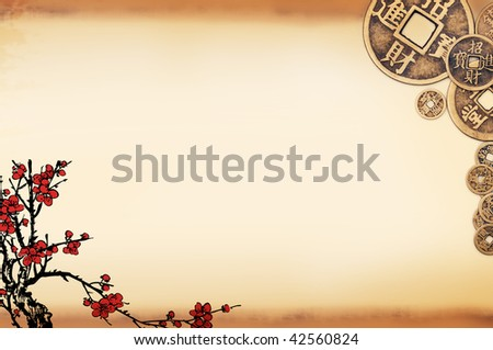 Traditional plum pattern and ancient copper coins on a vintage background,large copy space for your text. - stock photo