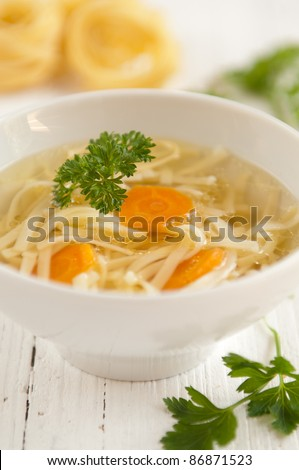 Traditional polish chicken broth in a bowl on a white background - stock photo