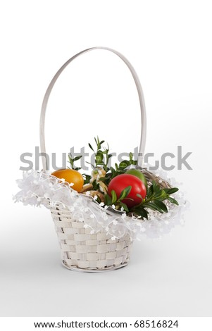 Traditional Polish Easter basket with eggs, bread, cake and box twigs. - stock photo
