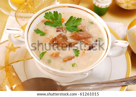 traditional polish mushroom soup with cream for christmas in white elegance dishware