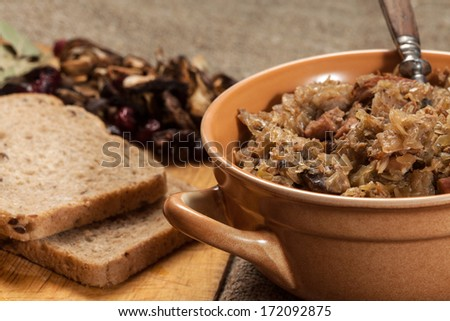 Traditional polish sauerkraut (bigos) with mushrooms and cranberries.