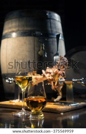 Traditional pork knuckle for a beer garden on a background of oak barrels