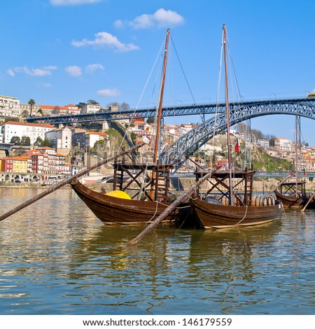 traditional port wine boats and bridge of Dom Luis I, Portugal - stock photo