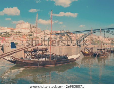 traditional port wine boats and Douro river embanment, Portugal, retro toned - stock photo