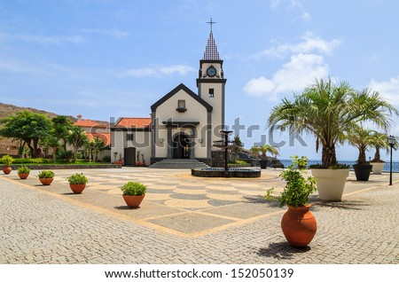 Traditional Portuguese church building and square with flower pots and ocean view, Madeira island, Portugal  - stock photo