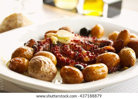traditional portuguese dish octopus with potato - stock photo
