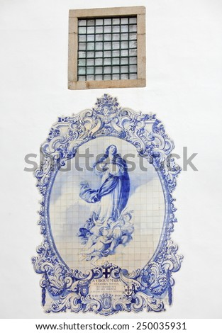 Traditional portuguese tilework exterior detail of church in Guimaraes, Portugal - stock photo