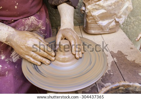 Traditional Potter, detail of manual work, arts and crafts - stock photo