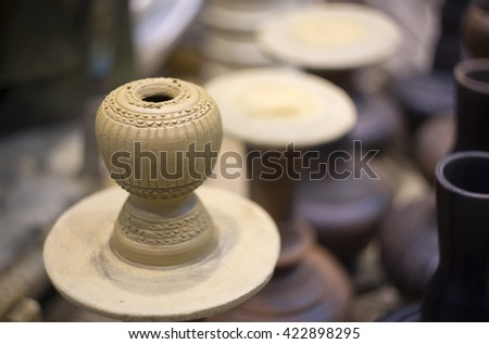 traditional pottery making, close up of potter's hands shaping a bowl on the spinning by clay, mold, crockery, earthenware, terracotta pot - stock photo
