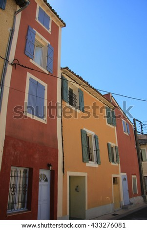 Traditional Provencal houses with plastered facades in bright colors  - stock photo