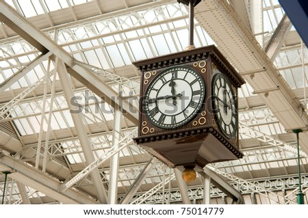 Traditional public clock in cast iron station in Glasgow, Scotland. - stock photo