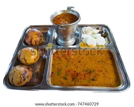 Traditional Rajasthani Food Daal Baati and Salad White Background. Indian Village Food Dal Bati.