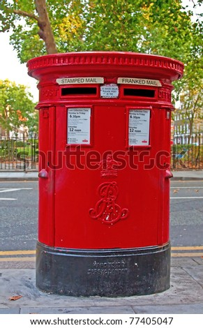 Traditional red mail-box in London, UK - stock photo