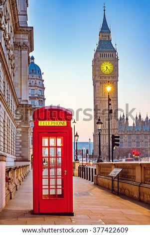 Traditional red phone booth and Big Ben in London - stock photo