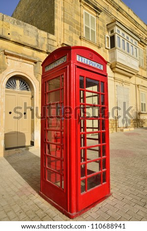 Traditional red phone booth in Malta - stock photo